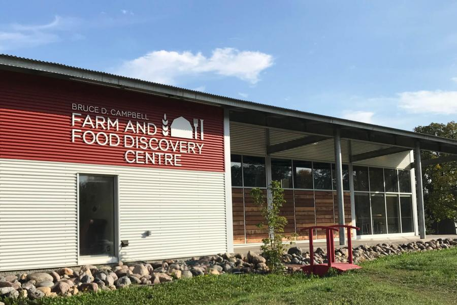 An exterior view of the Bruce D. Campbell Farm and Food Discovery Centre building.
