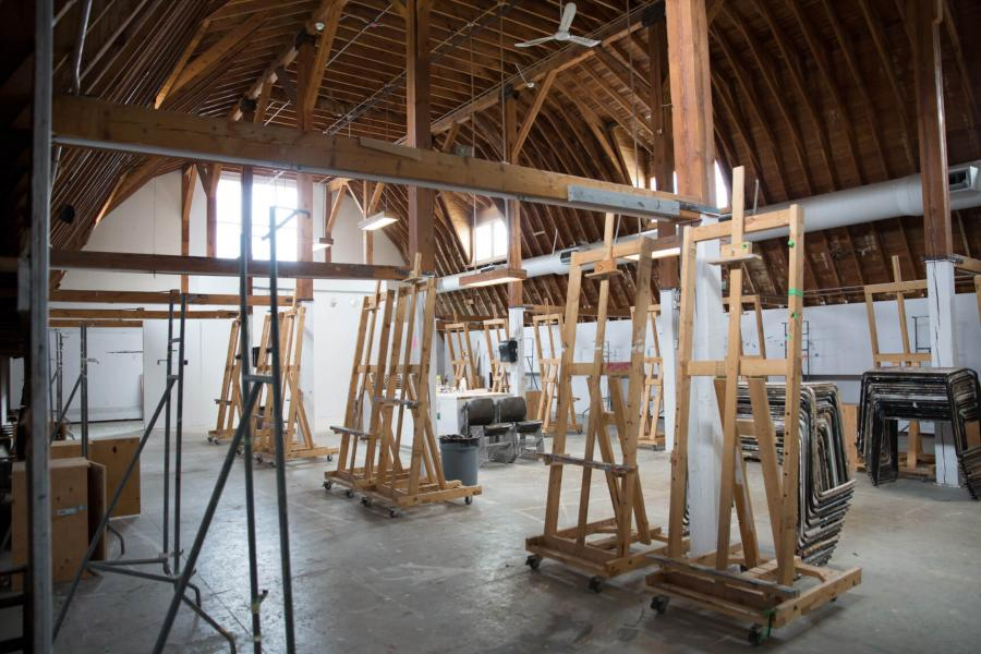 The spacious painting space inside the Art Barn with large easels placed around the room.