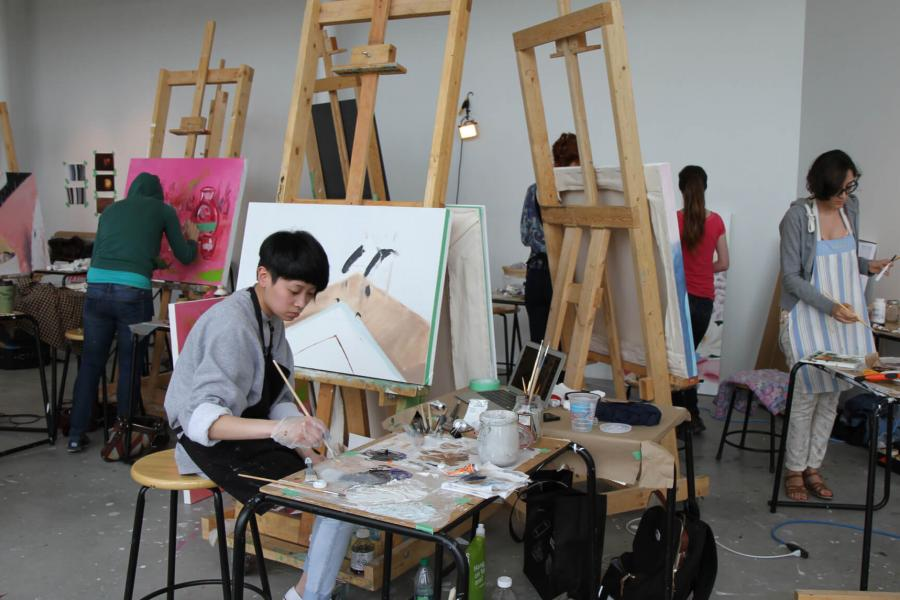 School of Art students working in a painting studio.