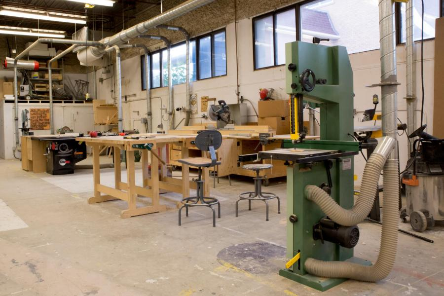 Interior view of the sculpture building with various pieces of equipment placed around the room.