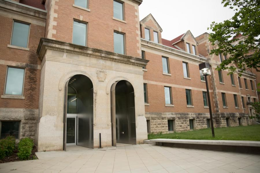 The main front entrance of the Tache Hall building.