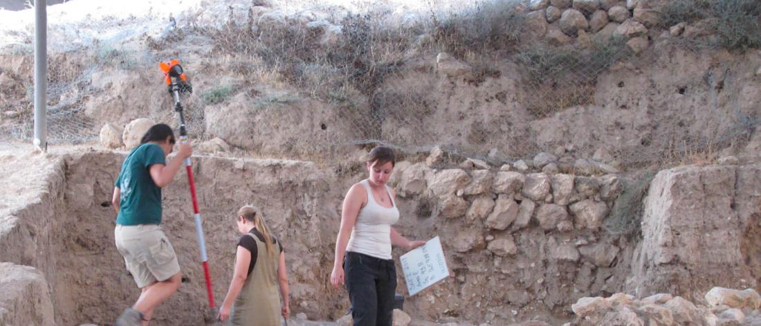 Anthropology students work at a digging site.