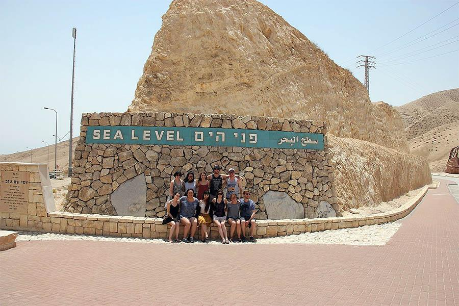 Group of students on exchange in the desert of Israel.