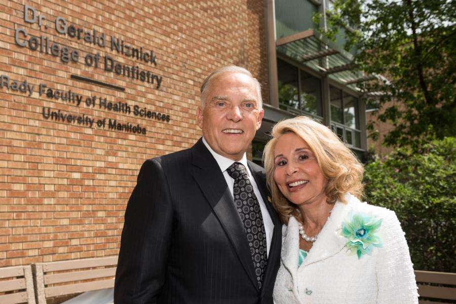 Dr. Gerald Niznick stands side by side with his wife Reesa Niznick outside the Dentistry building.