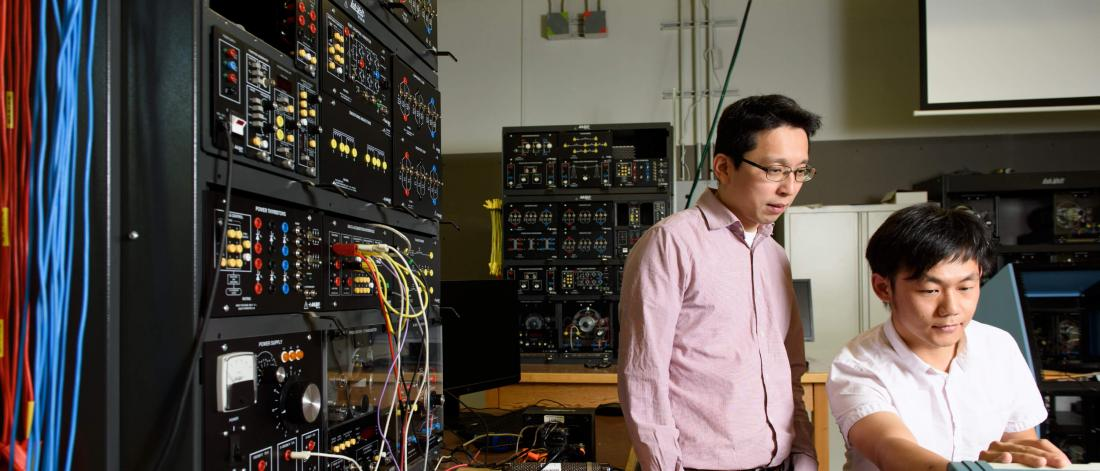 U of M researcher Carl Ho works in a lab.