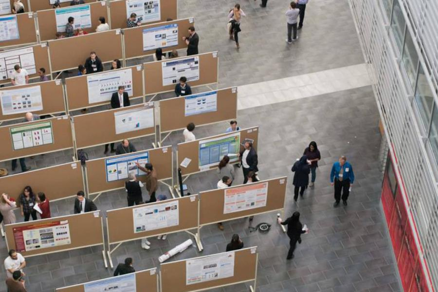 A student poster competition on display inside the atrium of the engineering complex.