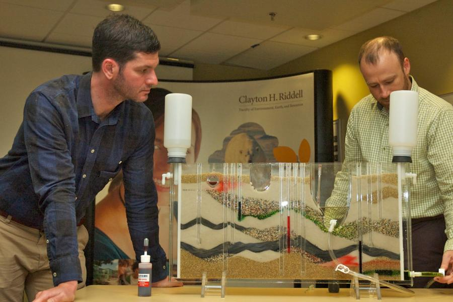Faculty members demonstrating ground water model