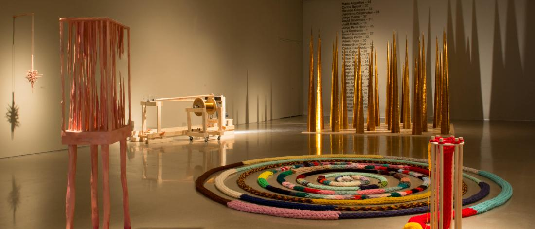 The School of Art Gallery featuring a display of Master of Fine Art student work including a hand knit loop rug, and tall wire wrapped narrow pyramid structures.