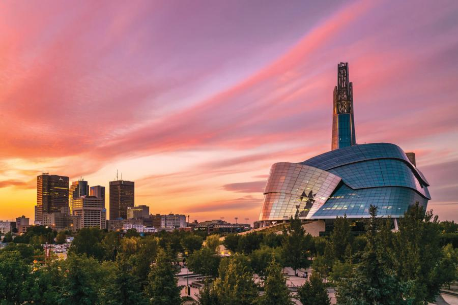 A sunset view of Winnipeg overlooking downtown and the Human Rights Museum.