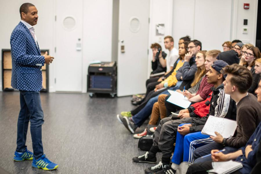 Delfeayo Marsalis, acclaimed jazz trombonist from the Marsalis family speaks in front of a group of music students. .