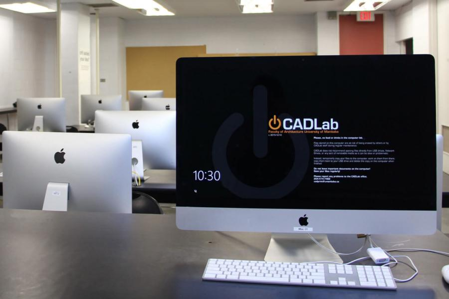 An interior view of the CAD lab with several rows of iMac computers lines up along long narrow tables.