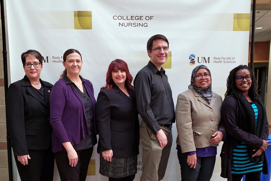 Staff from the Manitoba Centre for Nursing Health Research stand together for a photo.