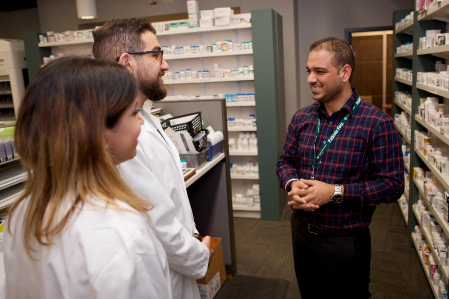 Preceptor discusses pharmacy with two new pharmacy students.