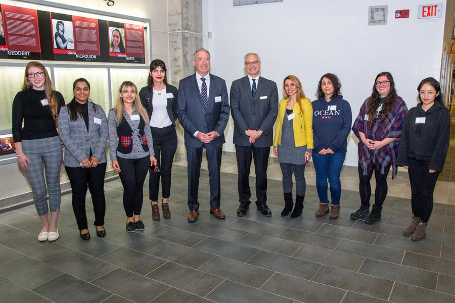 Eight awards winning female engineering students stand for a photo.