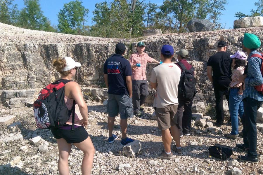 An engineering advisor and students visiting a limestone quarry.