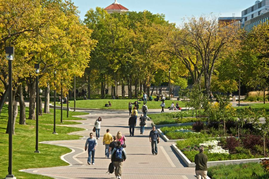 A busy outdoor walking path at the University of Manitoba Fort Garry campus.