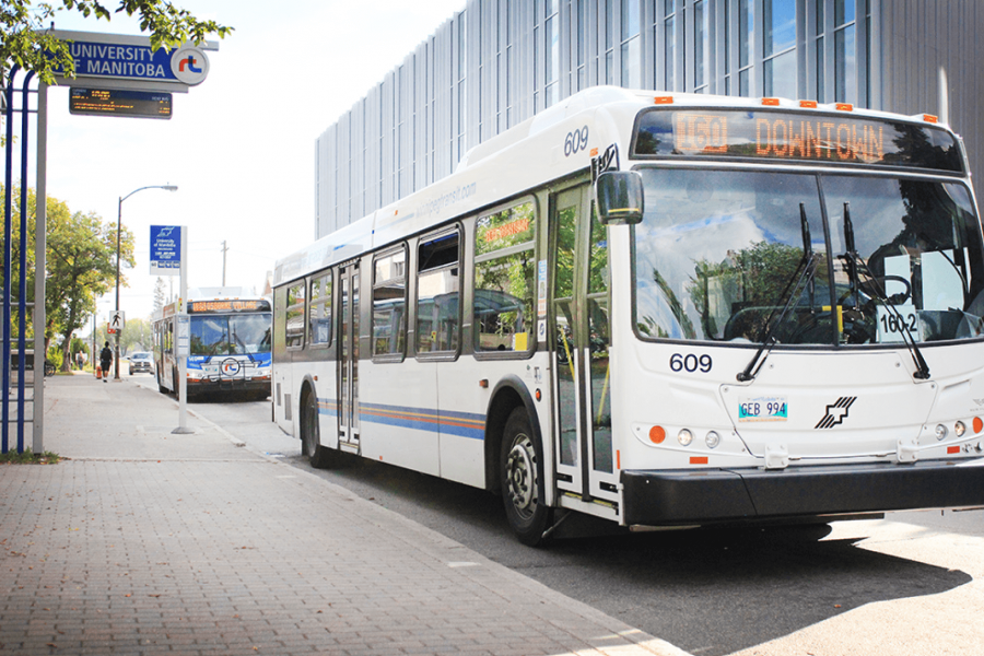A bus waits for passengers at the University of Manitoba Rapid Transit bus stop.