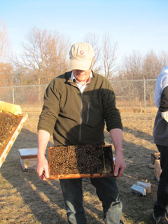 Instructor holding apiary bee tray.