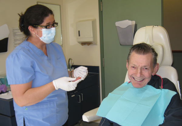 Hygienist with a senior patient