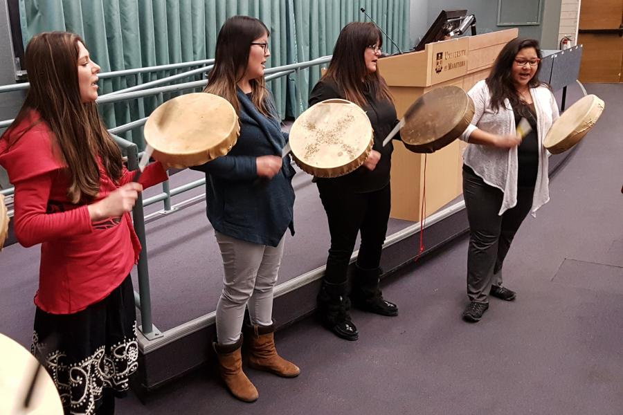 Group of Indigenous drummers welcomes guests to an event