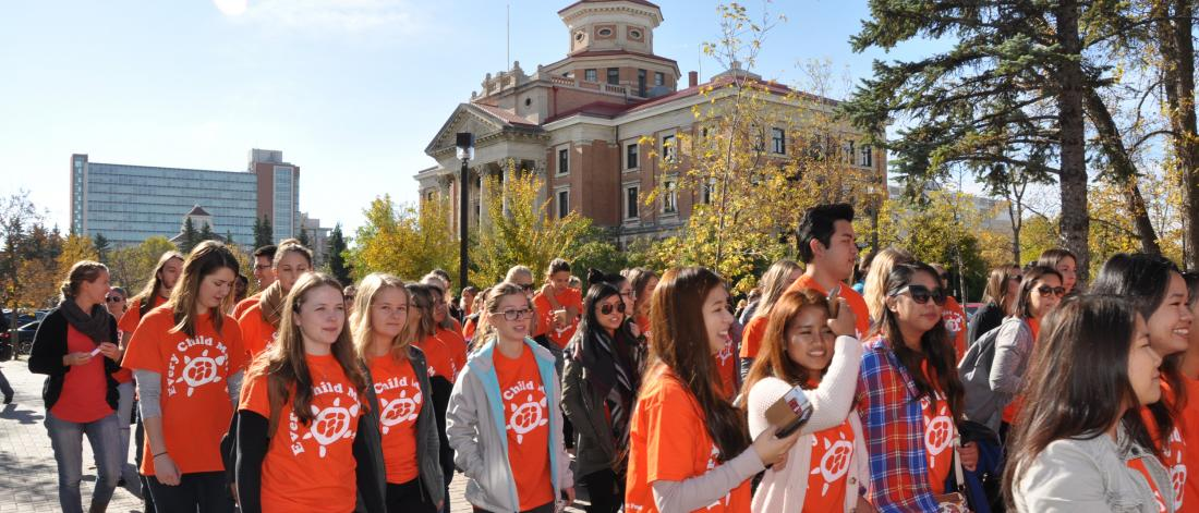 Participants in Orange Shirt Day march together at the University of Manitoba Fort Garry campus.