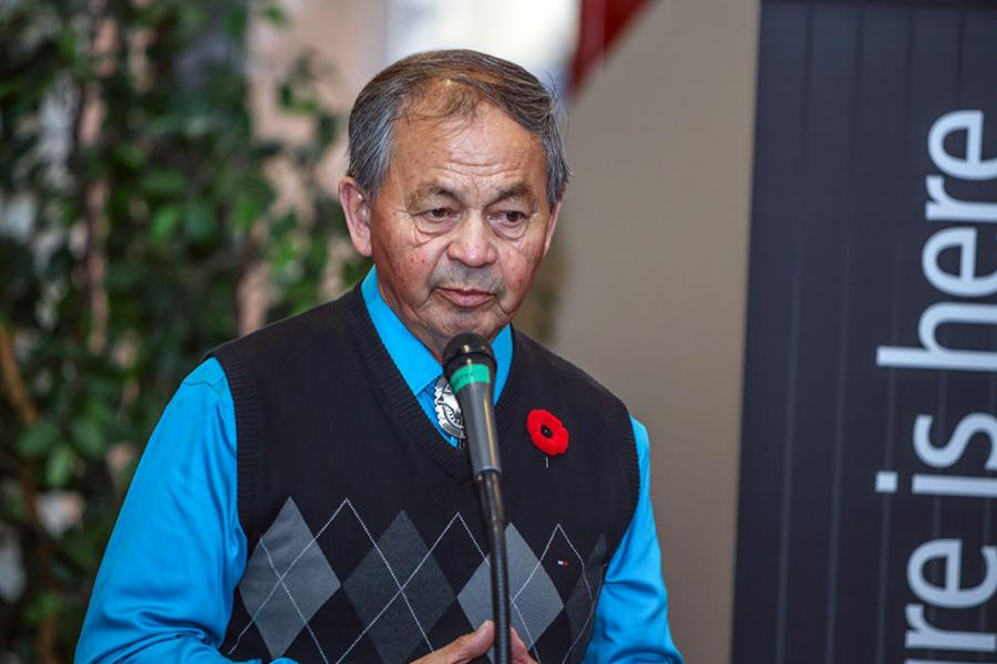 Elder in residence Norman Meade speaking at a celebration.