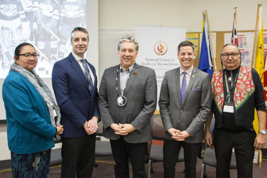 Dr. Moneca Sinclaire, MLA Andrew Smith, MP Dan Vandal, mayor Brian Bowman and Cultural Teacher and Leader Carl Stone stand together at the Sport and Reconciliation Gathering.
