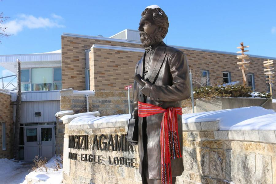 Statue of Louis Riel wearing a Metis sash outside of Migizii Agamik - Bald Eagle Lodge.