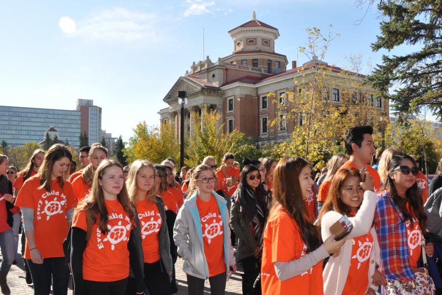 Participants of Orange Shirt Day march together at the University of Manitoba Fort Garry campus.