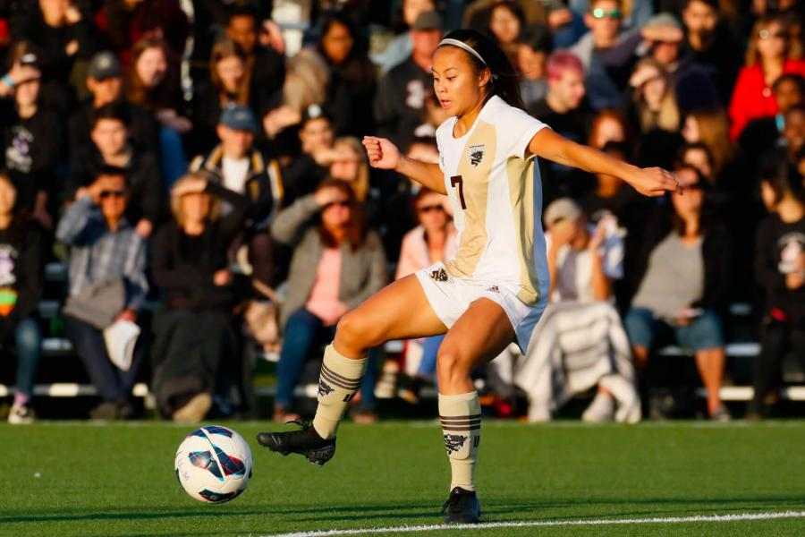 A Bisons women's soccer player preparing to kick the ball.