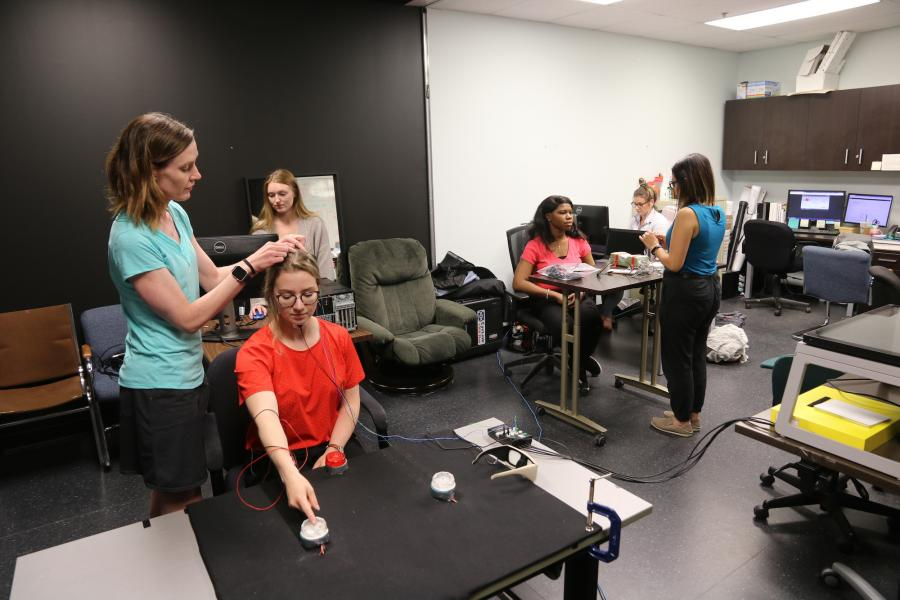 researcher and students conducting research in motor integration lab