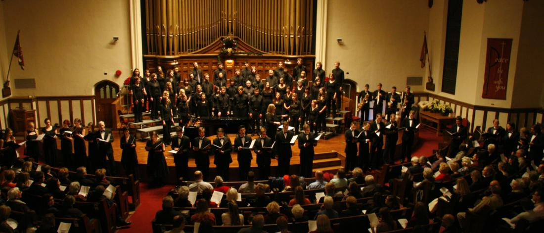 A concert choir ensemble performing.