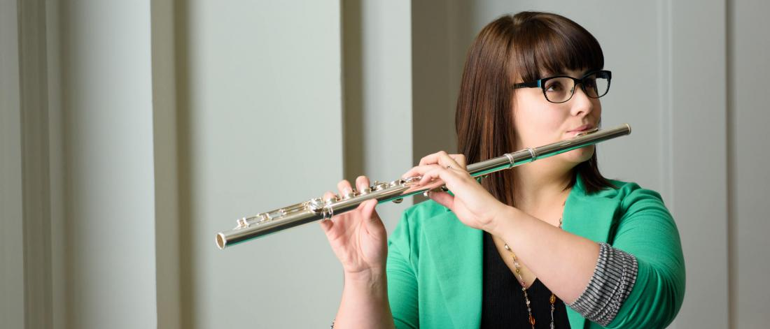 A student plays the flute.