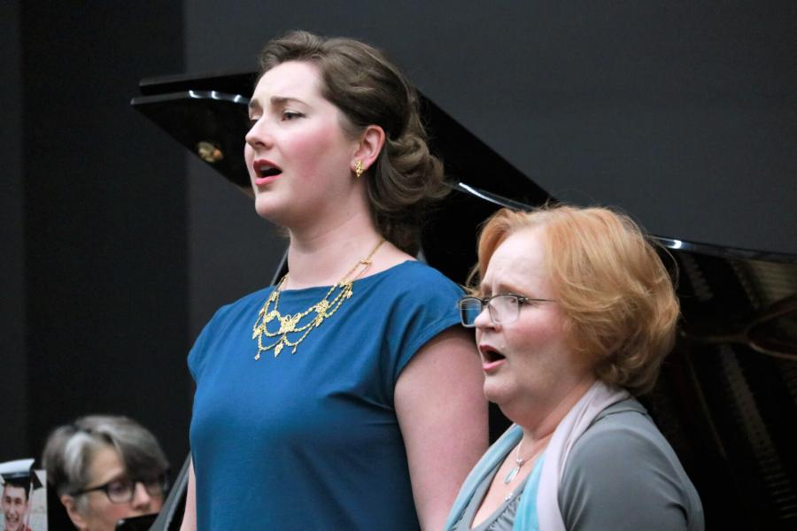 Desautels faculty members Elizabeth Hoyt-Surdhar and Tracy Dahl sing during a Faculty Midday Series titled Mysterious Barricades.
