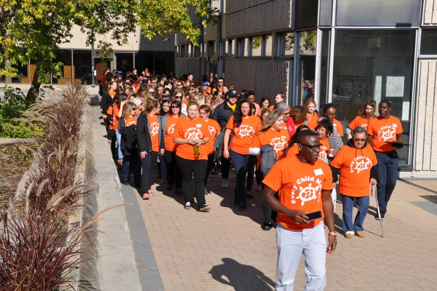 Students and staff walking for Orange Shirt Day