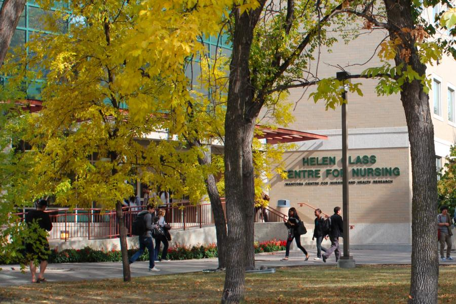 Students walking to and from class outside of the Helen Glass Centre for Nursing on a fall day.