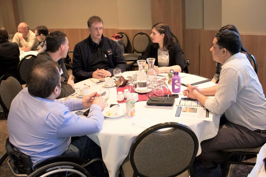 Group of community members having a discussion over lunch