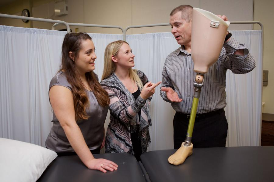 Students learn about a prosthetic leg
