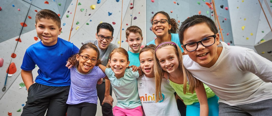 MiniU students in front of the climbing wall at the University of Manitoba Active Living Centre
