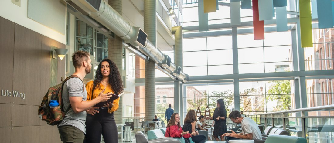 Students inside the University of Manitoba Bannatyne campus Buhler Atrium.