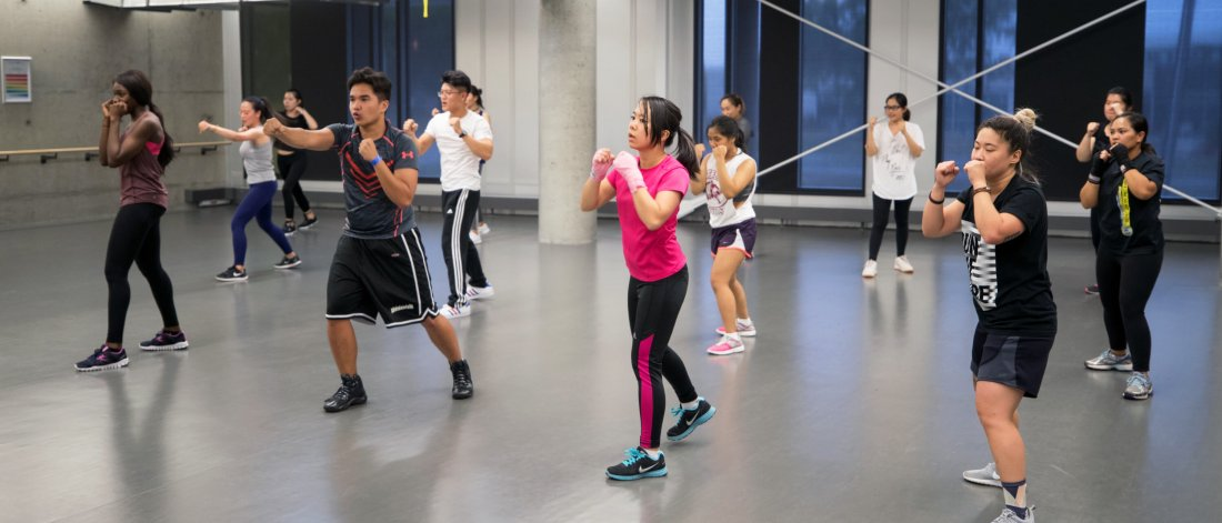 A engaged group of people participating in a group fitness class.