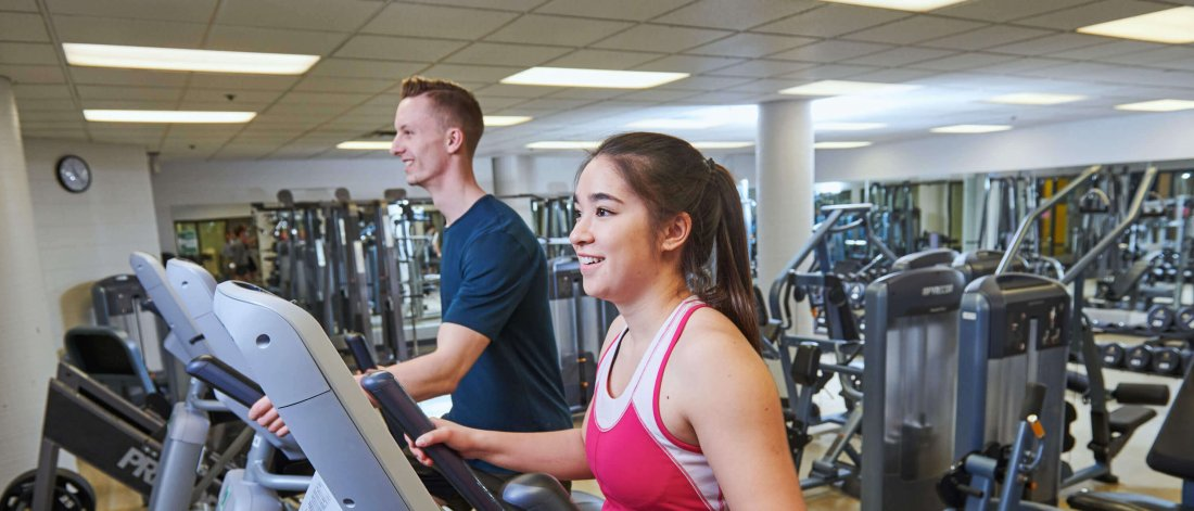 Two Joe Doupe recreation centre members run on treadmills.
