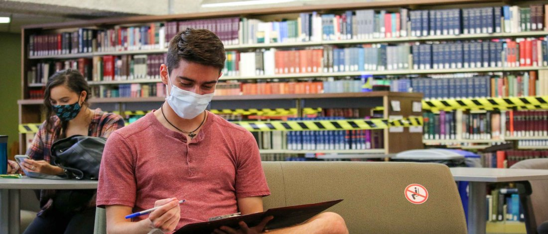 Students socially distancing on campus wearing masks