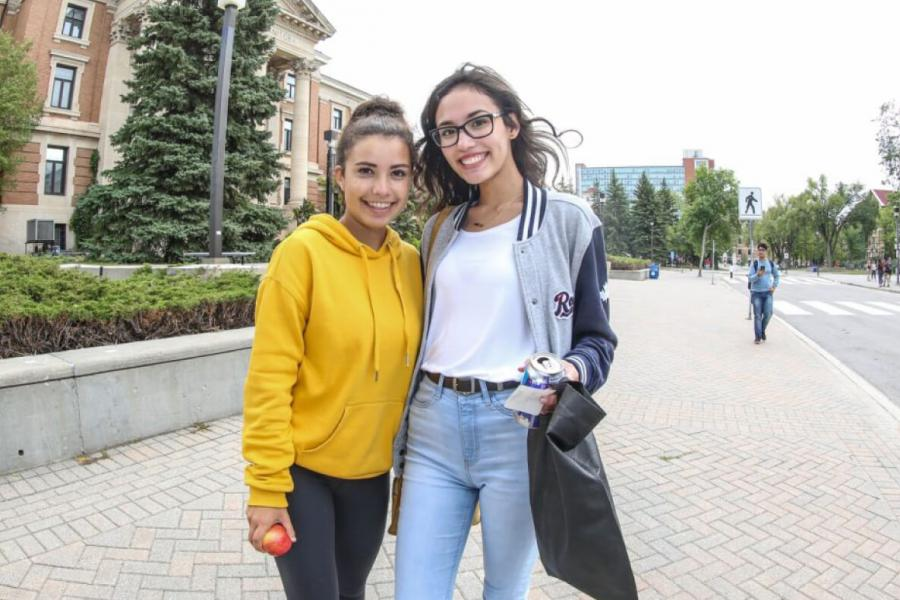 Two University of Manitoba students outside the Administration building.
