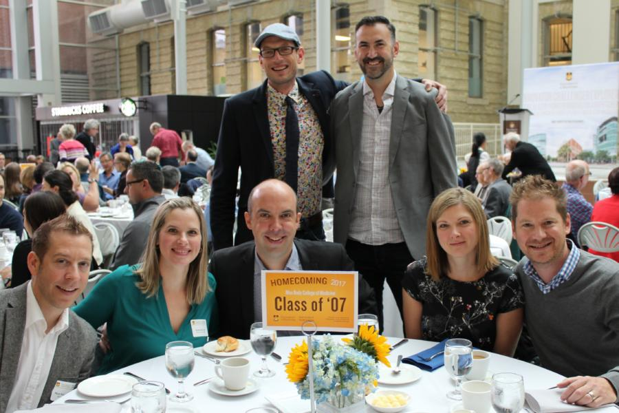A group of 7 University of Manitoba Alumni at a class reunion.