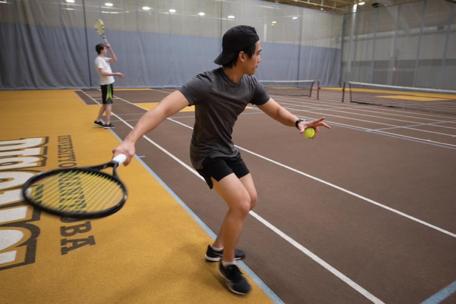 University of Manitoba REC clubs two men playing tennis