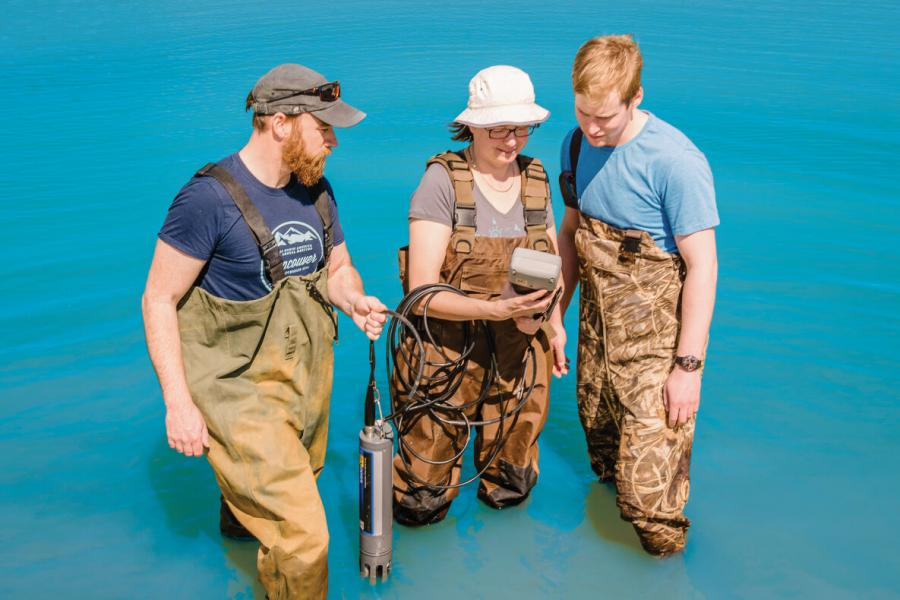 University of Manitoba researchers taking measurements in a body of water.