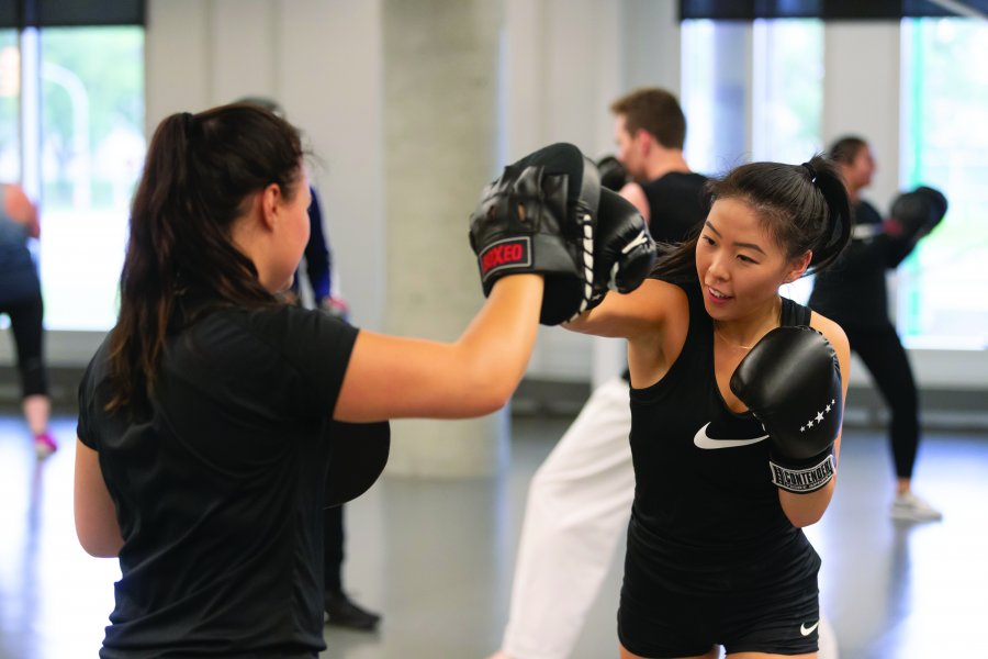 two people engaging in boxing training