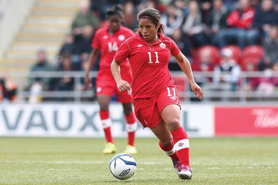 Desiree Scott on the soccer field playing for the Canadian National Women's team