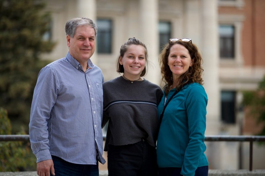Parents and a student on campus